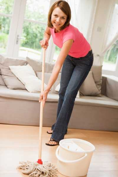 a woman mopping floor with diy natural floor cleaner