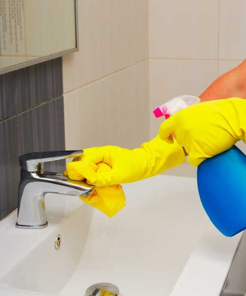 cleaning bathroom sink area