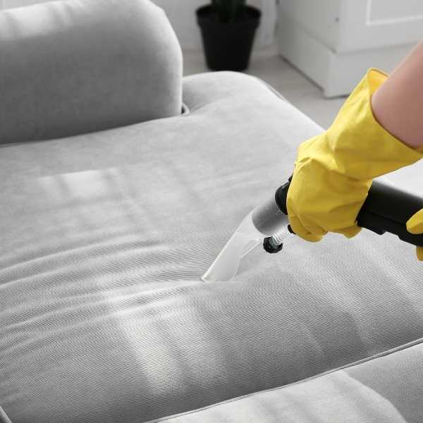 Cleaning a sofa with a steam cleaner